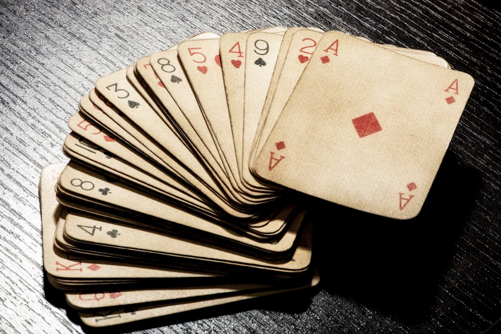 How can I clean my playing cards?
