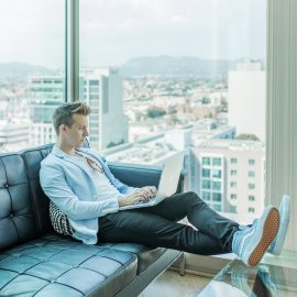 Man on Sofa Using Laptop - Great Bridge Links