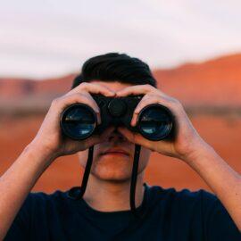 How Can I Watch Bridge - Man with binoculars - Great Bridge Links